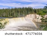 Kakisa River Lady Evelyn Falls in morning direct sunlight and rainbow - Northwest Territories, Canada