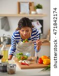 young woman preparing salad in... | Shutterstock . vector #471842174