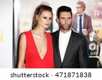 "Small photo of NEW YORK-JUNE 25: Behati Prinsloo (L) and Adam Levine attend the New York premiere of ""Begin Again"", sponsored by Delta Airlines and Budweiser at the SVA Theater on June 25, 2014 in New York City."