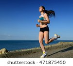 girl on morning jog in nature. | Shutterstock . vector #471875450