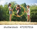 boy jumps through hula hoop... | Shutterstock . vector #471937016