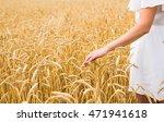 woman walking in the wheat ... | Shutterstock . vector #471941618
