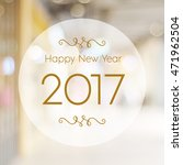 Small photo of Happy New Year 2017 year on abstract blur festive bokeh background