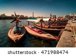 Small photo of Traditional Abra taxi boats in Dubai creek - Deira during sunny day, Dubai Deira, United Arab Emirates