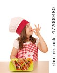 little girl cook with tacos...