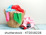 clothes in a laundry wooden... | Shutterstock . vector #472018228