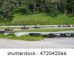 group of people driving go kart ... | Shutterstock . vector #472042066