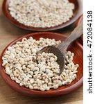 organic millet grains on wooden ... | Shutterstock . vector #472084138