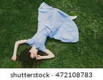 Brunette Woman Lying On Green...