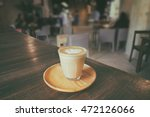a cup of piccolo latte with... | Shutterstock . vector #472126066