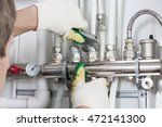 worker fixing heating system ... | Shutterstock . vector #472141300