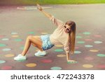Happy Girl Playing Twister Gam...