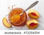 jar of peach jam on white... | Shutterstock . vector #472256554