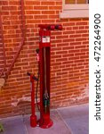 Small photo of Lancaster, PA - August 20, 2016: A public air pump for bicylists in downtown in the City of Lancaster in an alley way at the Central Market.
