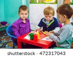 children painting with leaves... | Shutterstock . vector #472317043