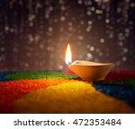 traditional diya lamp lit on... | Shutterstock . vector #472353484