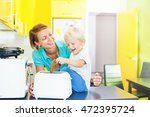 mother and son making toasts in ... | Shutterstock . vector #472395724