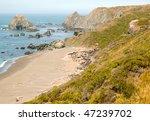 Sand Beach And Coastal Rock...