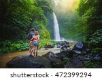 couple looking at the gorgeous... | Shutterstock . vector #472399294