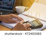 selective focusof man with... | Shutterstock . vector #472403383