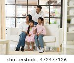 happy indian family at living... | Shutterstock . vector #472477126