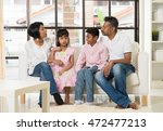 happy indian family at living... | Shutterstock . vector #472477213
