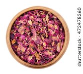 Stock photo dried rose petals in a wooden bowl on white background used for perfumes cosmetics teas and 472478260