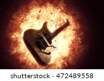 exploding electric guitar | Shutterstock . vector #472489558