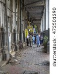 Small photo of MUMBAI, INDIA - OCTOBER 9, 2015: Unidentified people on the street of Mumbai. With 12 million people, Mumbai is the most populous city in India and the 9th most populous agglomeration in the world.