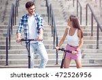 cheerful friends riding... | Shutterstock . vector #472526956