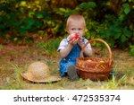 little boy with a basket of... | Shutterstock . vector #472535374