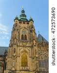 Small photo of Tall gothic styled tower adjoining medieval church under a clear blue sky