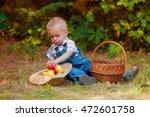 little boy with a basket of... | Shutterstock . vector #472601758