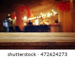 image of wooden table in front... | Shutterstock . vector #472624273