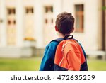 Boy With Rucksack Infront Of A...
