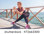 young woman doing stretches... | Shutterstock . vector #472663300