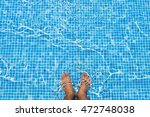 Bare Feet Cooling Off In The...