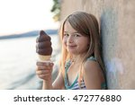 a beautiful little girl eats... | Shutterstock . vector #472776880