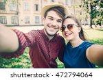 young couple doing selfie.... | Shutterstock . vector #472794064