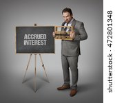 Small photo of Accrued interest text on blackboard with businessman