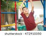 little asian boy climbing up at ... | Shutterstock . vector #472910350