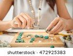 jewelry designer using pliers... | Shutterstock . vector #472925383