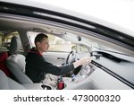 young driver with a smile and... | Shutterstock . vector #473000320
