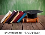 graduation cap and books... | Shutterstock . vector #473014684