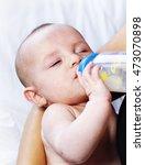 beautiful baby drinking milk.... | Shutterstock . vector #473070898