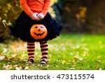 Small photo of Little girl in witch costume playing in autumn park. Child having fun at Halloween trick or treat. Kids trick or treating. Toddler kid with jack-o-lantern. Children with candy bucket in fall forest.