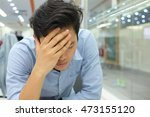 Small photo of close up employee hand gesture palm up over face and head for stress , major of depressive disorder concept