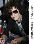 MEXICO CITY- FEB 16: Singer Enrique Bunbury promotes his new album 'Las Consecuencias ''The Consecuences' at MixUp Music Store Plaza Loreto on February 16, 2010 in Mexico City, Mexico. - stock photo