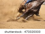 Stock photo a front view of a horse galloping and sliding in the dirt 473320333
