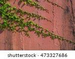 climbing on concrete wall... | Shutterstock . vector #473327686